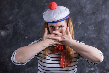 Beautiful midle aged lady having fun in sailors suit Stock Photo - 164672130