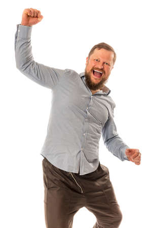 Joyful bearded man in shirt is happy to win Standard-Bild