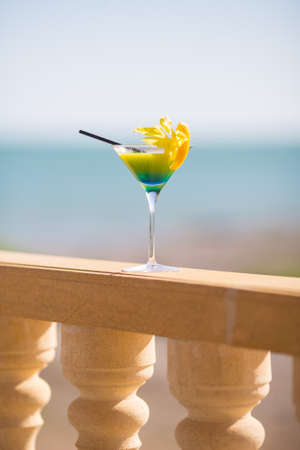 Beautiful scene with cocktail glass standing alone