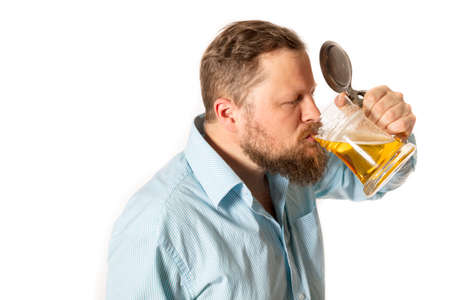 Solid smiling bearded man in shirt with beer mug studio portrait