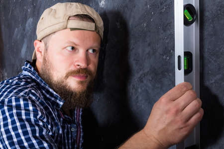 Solid bearded foreman with a plumb studio portrait.