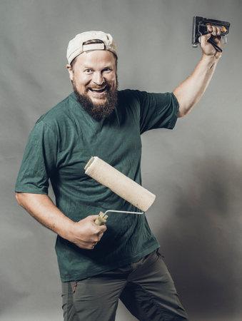 Joyful bearded craftsman in green t-shirt having fun