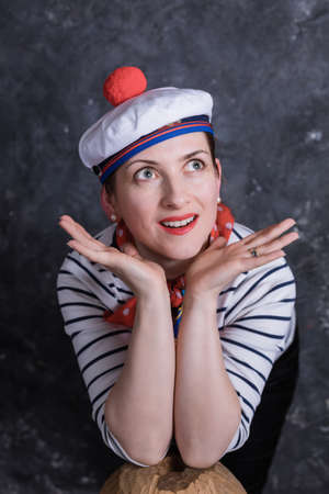 Beautiful midle aged lady having fun in sailors suit