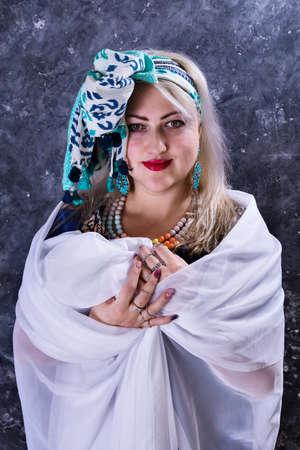 Attractive plump woman dressed in beautiful blue dress Standard-Bild