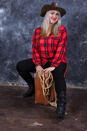 Attractive plump woman dressed in cow boy style