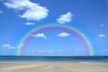 pristine corals: Colorful rainbow over a Tropical beach of Andaman Sea Thailand