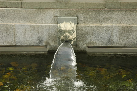 out of water: Chinese style hot spring pool with dragon head statues flowing out water