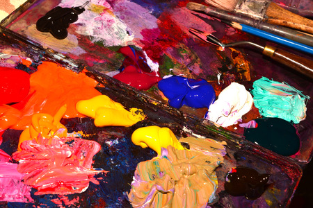 Paintbrushes and Palette-knife on the palette for mixing oil paints