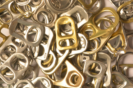 can opener: Background of many ring pull can opener, silver and gold.