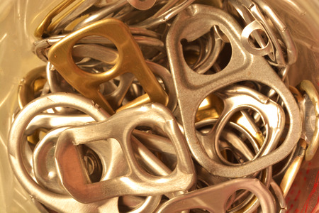 ring pull: Background of many ring pull can opener, silver and gold.