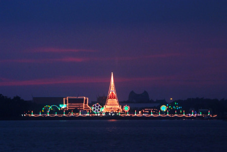 The temple Phra Samut Chedidecorated during a temple festival, The light reflected in the Chao Praya River, in Samut Prakan, Thailand