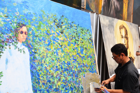 adulyadej: BANGKOK, THAILAND - November 12,2016 : Thai art students paint portraits of Thai King Bhumibol Adulyadej at Silpakorn University in Bangkok. King Bhumibol, the worlds longest reigning monarch.