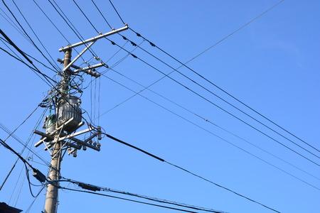 electricity transmission pylon against blue sky Stock Photo