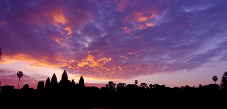 Silhouette of Angkor Wat temple in the sunrise panorama