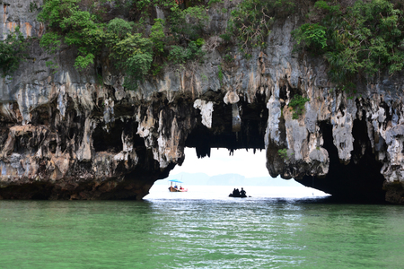 Tham Lod Yai (Grotto Cave) Jungle covered limestone cliffs at Phang Nga Bay