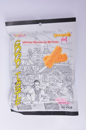 KANCHANABURI, THAILAND – March 7, 2017 : Products from the Thai border Myanmar white sesame brittle (good taste)