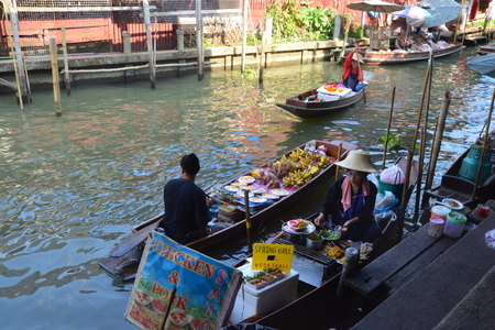 RATCHABURI,THAILAND- MAY 13 2017 : Damnoen Saduak Floating Market is a very attractive place for tourists to see traditional way of selling and buying goods in Thailand.