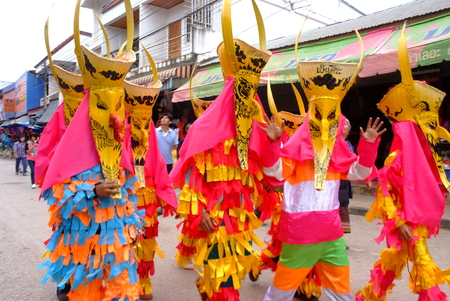 LOEI, THAILAND - JUNE 25, 2017 : Phi Ta Khon is a type of masked procession celebrated on the first day of a three-day Buddhist merit-making holiday known in Thai as Boon Pra Wate