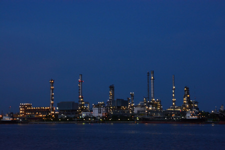 Oil Refinery factory in the evening , petrochemical plant , Petroleum.