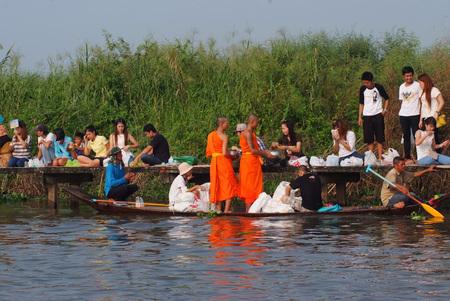 BANGKOK, THAILAND – OCTOBER 8, 2017 : Tuk baat Phra Roi River Festival (Give alms to a Buddhist monk on boat) On the Lamplatiew Canal in front of Wat Sutthaphot, Lat Krabang District Bangkok Editorial
