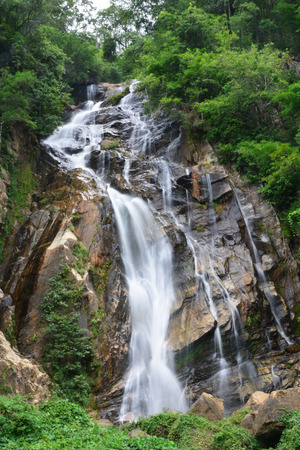 Mae Tia Waterfall Natural beauty of the streams flows gently joins the others and drops to reefs as layers of water that hit the reefs resulting in a terrifying sound inserted by appropriate movement Stock Photo