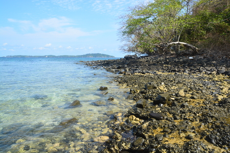 Koh Hin Ngam  is a unique small island unlike other island. Its covered with small black rocks in Tarutao Marine National Park in Satun Province, Thailand Stock Photo