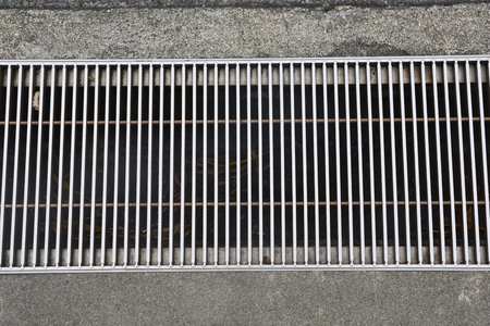 The drain cover,  metal street water sewer cover Stock Photo