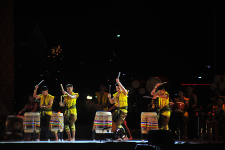 BANGKOK, THAILAND – 28 MAY 2019 : artiste have drum performance  are hit local ancient drum and culture dacing performance in traditional drum festival in Cultural to honour King at Sanam Laung