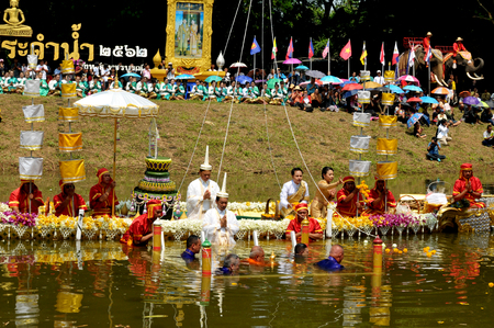 PHETCHABUN, THAILAND – 28  SEPTEMBER 2019 : Um Phra Dam Nam Ceremony , The Phetchabun Governor, representing all people, will carry the Buddha image and dive into the Pasak river facing 2 directions