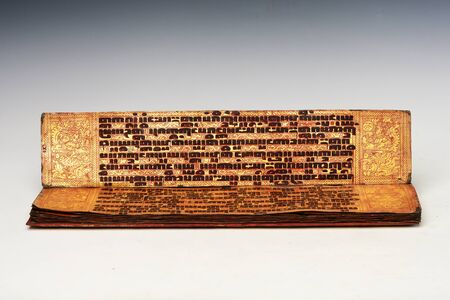 Burmese Manuscript (KAMMAVACA) lacquered palm leaves with large tamarind script written in black resin on red and gold background