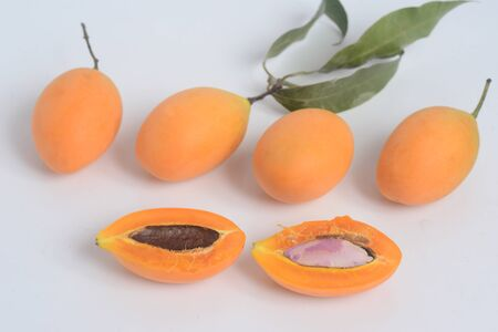 Sweet Marian plum or Plango in a wicker basket. Yellow-orange color tropical fruits. Thai fruits
