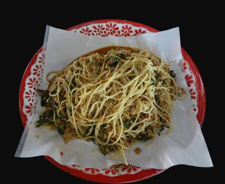 Spicy Stir Fried Spaghetti or Spicy Stir-fried Spaghetti with Chopped Chicken and holy basil on tray, Thai style food