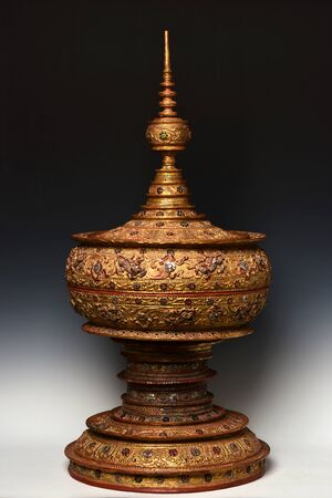 Vintage Large Burmese lacquered vessel with gilded gold and glass, Stupa shape lacquerware. Traditional Buddhist food offering vessel  Stock Photo