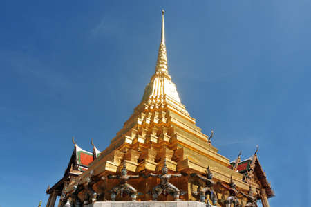 Two gilt chedis Part of Wat Phra Kaew no people, in the time of Corona Virus Disease (COVID-19) Bangkok, Thailand