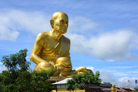 NAKHON RATCHASIMA, THAILAND – 9 AUGUST 2020 : A huge monk statue and wonderful park full of interesting statues  in Dhama Park Anachak Luang Pu Thuat Khao Yai