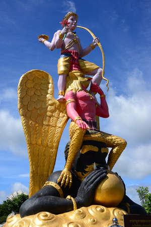 NAKHON RATCHASIMA, THAILAND – 9 AUGUST 2020 : Luang Pu Thuat in Meditation under a Seven-Headed Naga in Dhama Park Anachak Luang Pu Thuat Khao Yai
