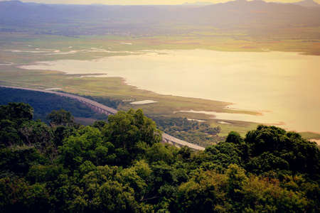 A scenic section of the new motorway connecting Bangkok with Nakhon Ratchasima runs along  Lamtakong reservoir in the northeastern province Looking from View Point Of Lamtakong Dam