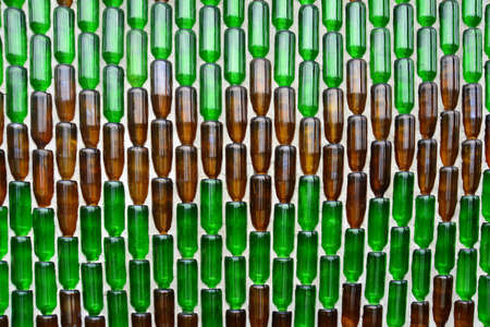 Pattern background from glass  bottles, Background with glass bottles  on the wall