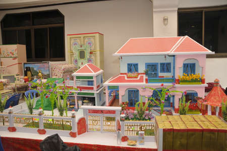 BANGKOK, THAILAND – 20 MARCH 2021 : replicas of house  and  gadgets for Chinese funeral ceremony, Chinese traditional burn paper Editorial