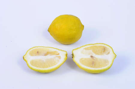 The lemon, Citrus limon, is a species of small evergreen tree in the flowering plant family Rutaceae, native to South Asia, primarily Northeast India. Stock Photo