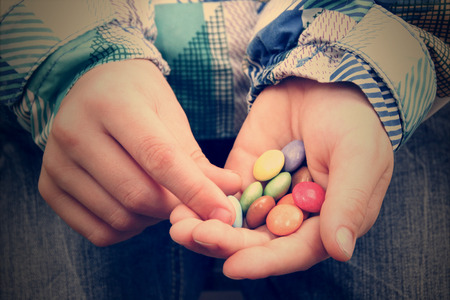 Pills in kid hands.