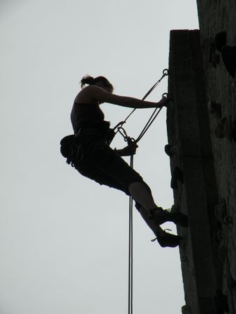 silhouette of climbing woman photo