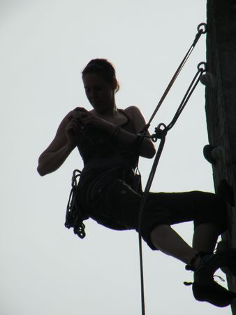 silhouette of climbing woman