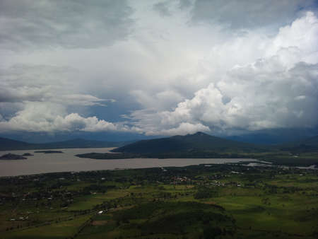exemplary: Exemplary panoramic view of Lake Patzcuaro from the viewpoint of the hill of the stirrup, cloudy summer da