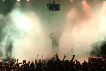 Stage smoke, lights and production at a music festival