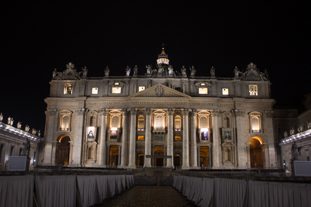 St Peter Cathedral at night in the Vatican City with lights Stock Photo