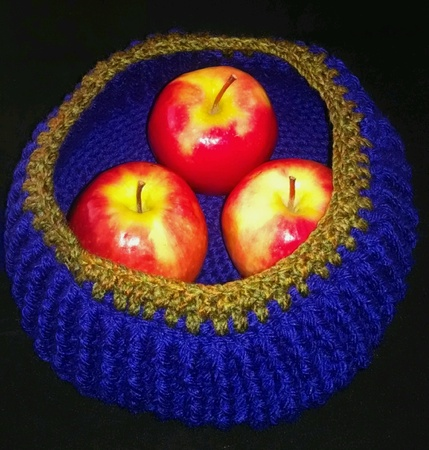 Blue crochet bowl with apples