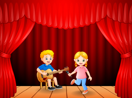 Little boy playing guitar and singing girl dancing