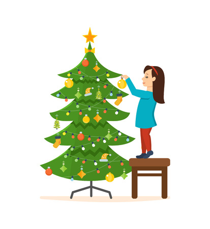 Girl standing on a stool, decorated with New Year Christmas.