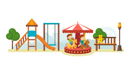 Children have fun in amusement park and ride on carousel.